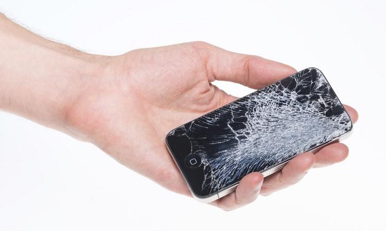 Broken Apple iPhone 4 in hand